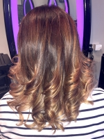 Caramel highlights finished with a curly blowdry